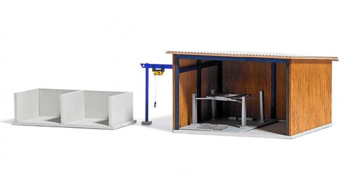 Hangar pour véhicules avec enceinte de stockage#