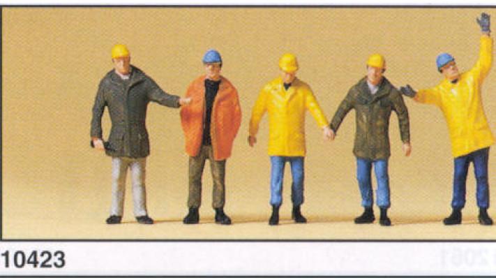 ouvriers avec vêtements de protecti