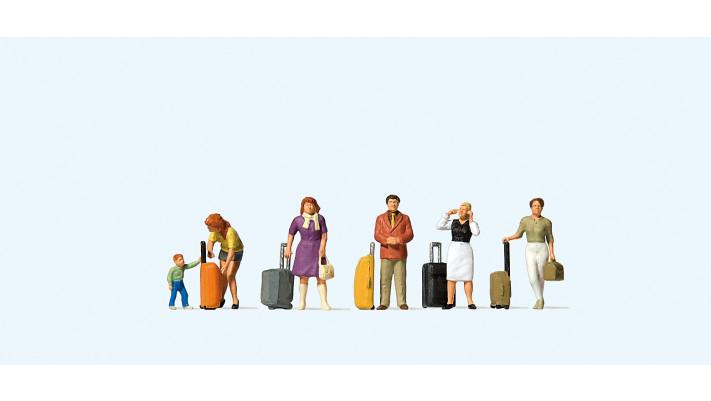 voyageurs avec valises à roulettes#