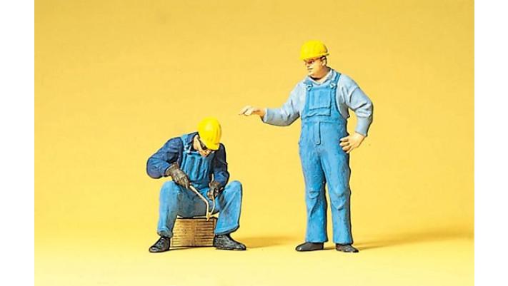 ouvriers avec casque de protection