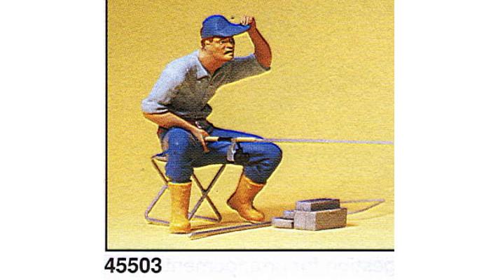 pêcheur avec accessoires
