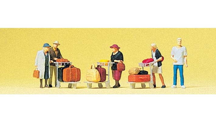 voyageurs+baggages sur un chariot