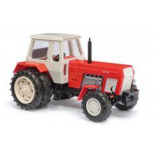 Tracteur rouge à roues jumelées